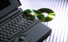 手提電腦與光碟片图片